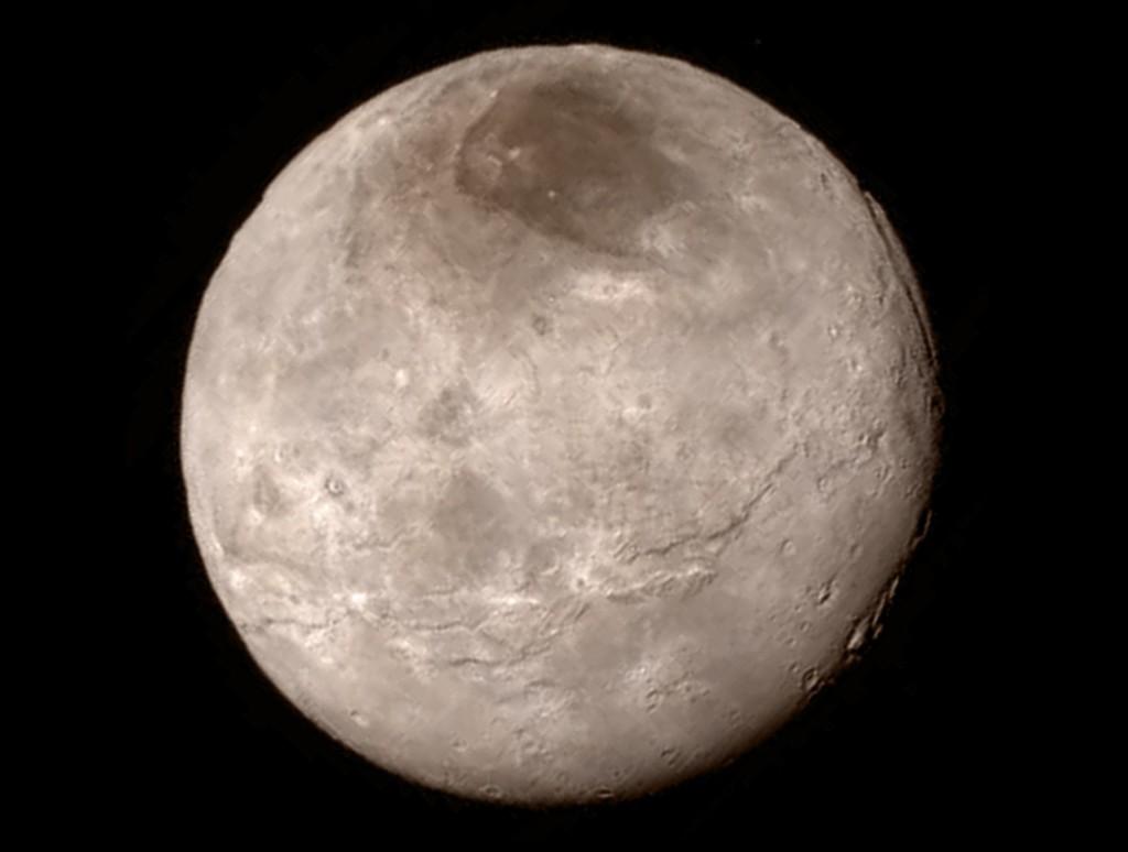 Charon księżyc Plutona - Foto: NASA/JHU APL/SwRI